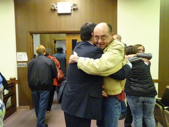 Mike Biederman, right, hugs Marion County Prosecutor