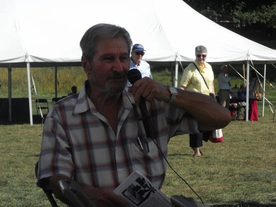 "Maynard Kauffman shares stories about his book ""The Organic Movement in Michigan"" at Tillers International's Harvest Festival."