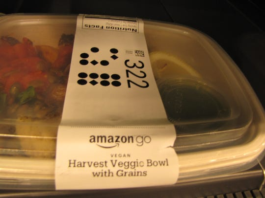 A salad for sale at Amazon's Amazon Go convenience store at the company's headquarters in Seattle. Store-made sandwiches, salads and other items come in plastic containers tagged with a dot-based readable system similar to a bar code. This is one way the store's multiple cameras are able to know what items the customer has selected.