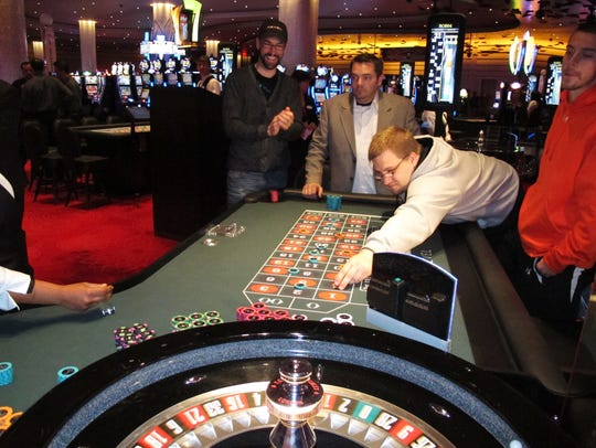 In this April 2, 2012 photo, customers place bets during