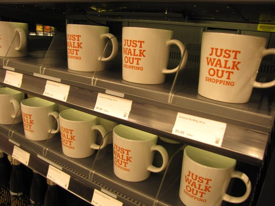 Just Walk Out shopping mugs for sale at the Amazon Go convenience store at Amazon's headquarters in Seattle. It features Just Walk Out technology which allows shoppers who have the Amazon Go app to walk in, grab what they want, and walk out - all without going through a checkout line. The items are automatically charged to their account.