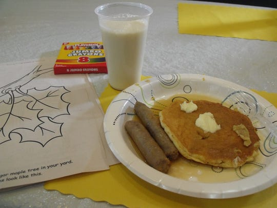 Butternut Creek Sugar Shack hosted an open house with a free pancake and sausage meal featuring their fresh maple syrup. Coloring sheets were provided to entertain the children.