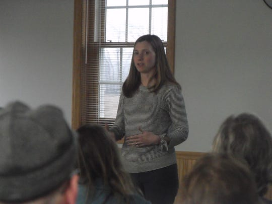 Manja Holland from National Wildlife Federation talks to an audience about grasslands and the benefits to having them on their property.
