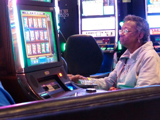 A woman playing slot machines at Resorts Casino Hotel