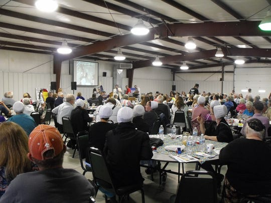 A large crowd supported The Farm project during the annual wheelbarrow auction and dinner.