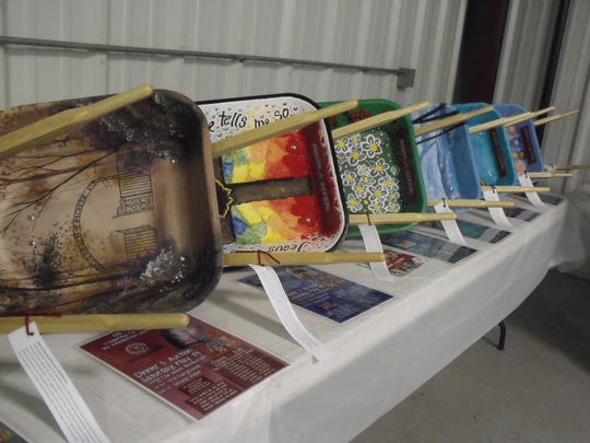 A few of the wheelbarrows that were sold at The Farm fundraiser at the LaGrange County 4-H Fairgrounds.