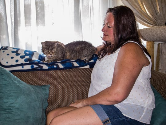 Dara Mazza, pictured with the family cat Tigger, speaks about her son Michael.