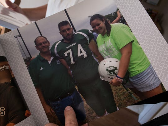 Michael Mazza, center, in his Mount Ida football uniform.