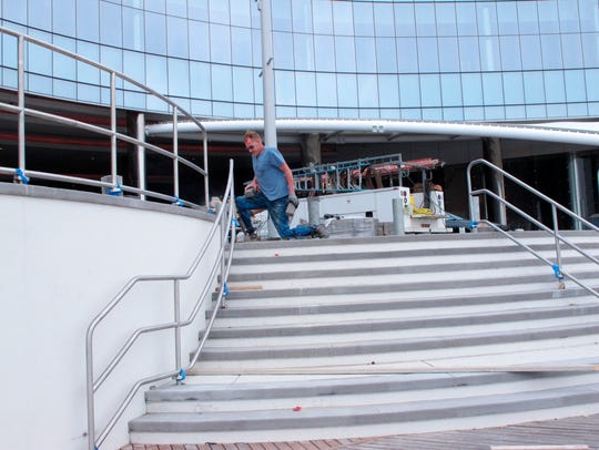 A worker puts the finishing touches on a staircase