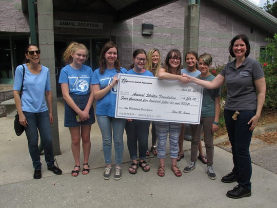 Erika Leckington receives a check for the ASF from