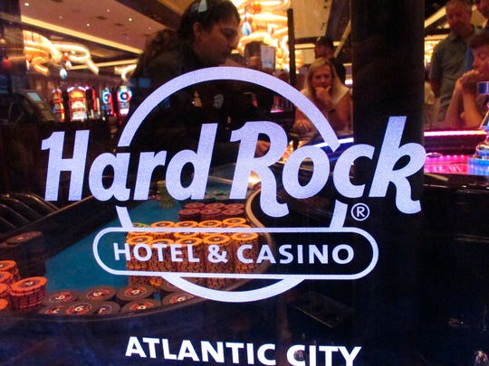 A roulette dealer works behind the glass at a table at the Hard Rock casino in Atlantic City, N.J.