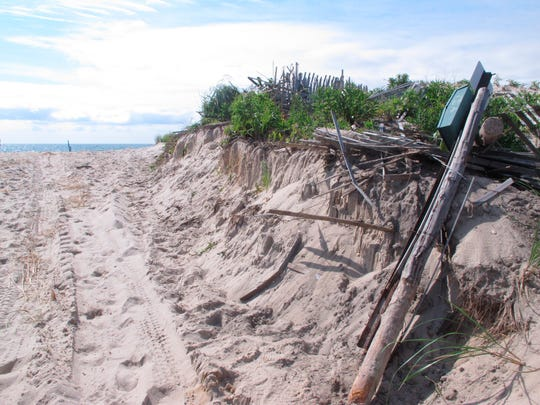 This July 31, 2018, photo shows a cut-through that was bulldozed a day earlier through a 40-year-old sand dune in Berkeley Township.
