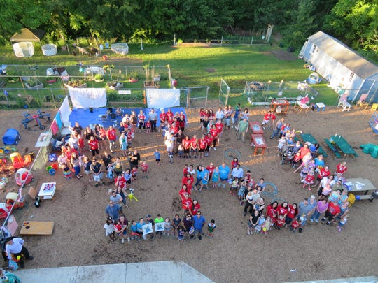 The Grand finale of Kangaroo Kids Family Carnival was to create a human puzzle piece in support of Autism Speaks!