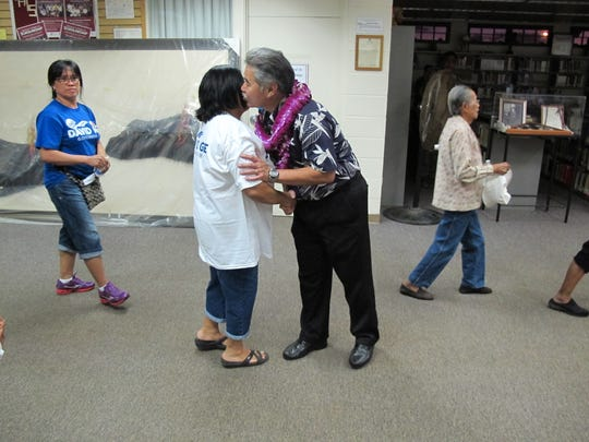 Democratic Hawaii state Sen. David Ige greets supporters
