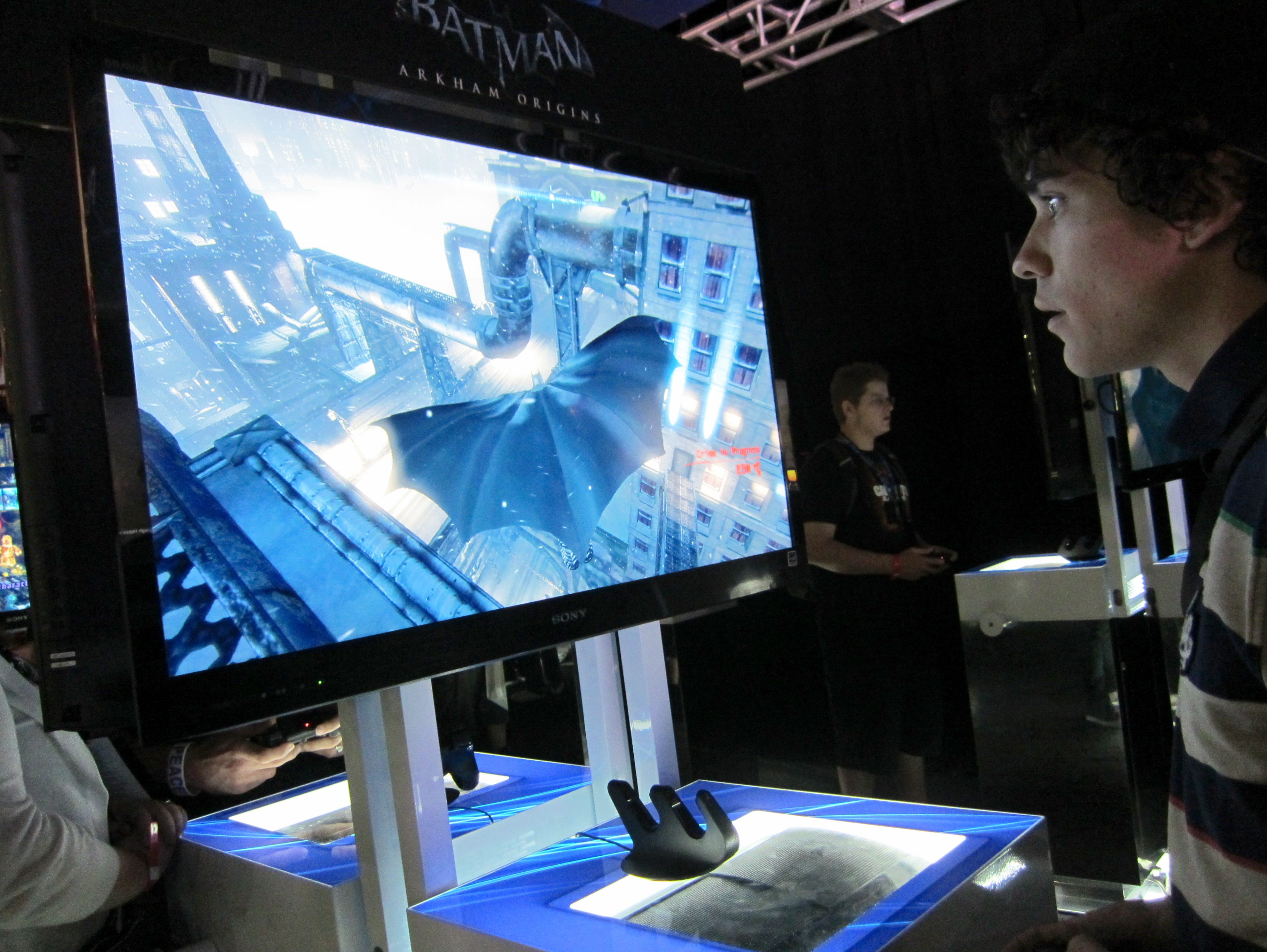 Andre Fontaine, 22, of Tucson, Ariz., plays the game Batman: Arkham Origins' on the PlayStation 4 at the GameStop Expo in Las Vegas in August 2013.