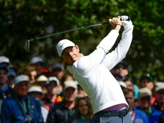 Rory McIlroy, of Northern Ireland, hits on the fourth hole during the fourth round at the Masters golf tournament Sunday, April 8, 2018, in Augusta, Ga. (AP Photo/Chris Carlson)
