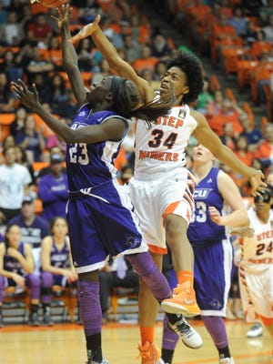 Abilene Christian's Suzzy Dimba (23) drives for a shot as Texas El Paso's Lawna Kennedy (34) defends. UTEP beat the Wildcats 66-62 in the first round of the Women's National Invitation Tournament last year at the Don Haskins Center in El Paso.