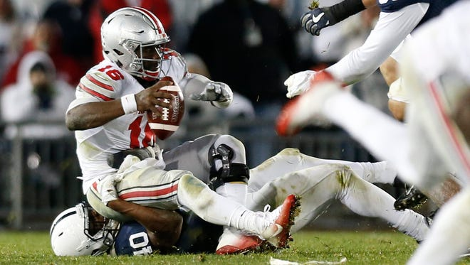 Ohio State quarterback J.T. Barrett (16) was sacked six times in the Buckeyes' loss to Penn State on Oct. 22.