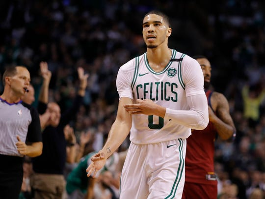 Boston Celtics forward Jayson Tatum (0) runs up the court during the second quarter against the Cleveland Cavaliers in game one of the Eastern conference finals of the 2018 NBA Playoffs at TD Garden.
