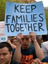 Keep Families Together, the sign says