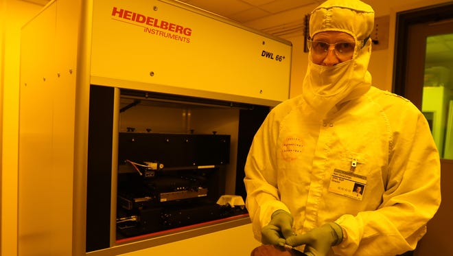 Karl Hirschman, professor of microelectronic engineering at Rochester Institute of Technology, shows an example of what the Heidelberg DWL66+ can do.  The direct write laser writes images on photo sensitive material to transfer patterns during fabrication of semiconductor devices.