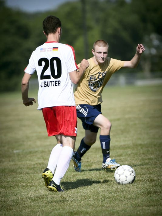 FC Hochrhein's Lukas Sutter (20) and Elco's Logan Royer (42) battle for the ball during Saturday's matchup in Myerstown.