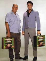 Tom Parker and Eivis Presley pose for a publicity photo