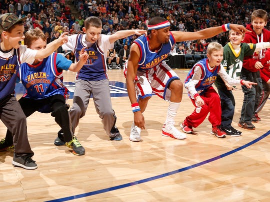 "Brawley ""Cheese"" Chisholm is shown with young fans at a Harlem Globetrotters game. The legendary team is offering free tickets to those affected by the partial government shutdown."