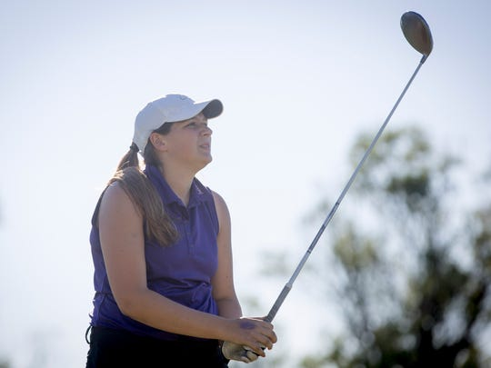 Kassidy McDonald competes in a match for Central Monday afternoon at the Hickory Hills Golf Course in Farmland.