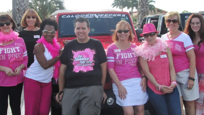 Members of Partners for Breast Cancer Care and Caloosa Jeepers of Southwest Florida President Joel Lounds.