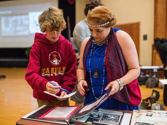 Ashton Menard, 15, and Vickie Hebert, a history teacher,