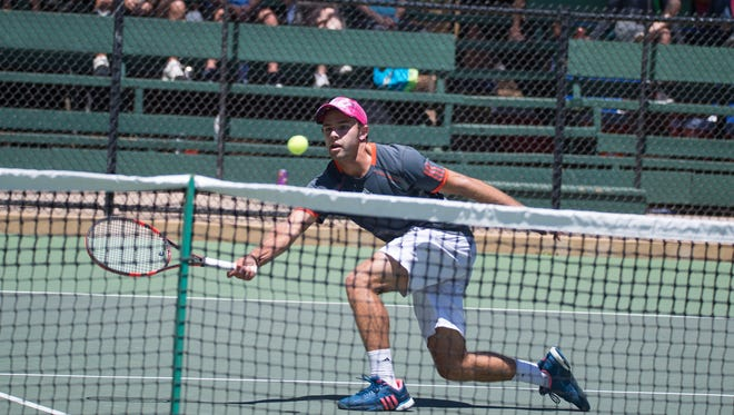 Murrieta native Henry Craig stretches to hit a volley during his victory in the Men's Open final Sunday at The Ojai.