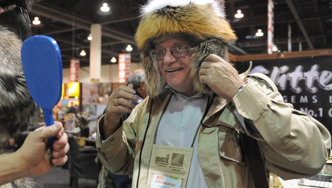 Derald Dixon of Canada tries on a fur hat during the Safari Club International annual convention in 2010 at the Reno-Sparks Convention Center in Reno. The event is returning to Reno in 2019 after a six-year absence in Northern Nevada.