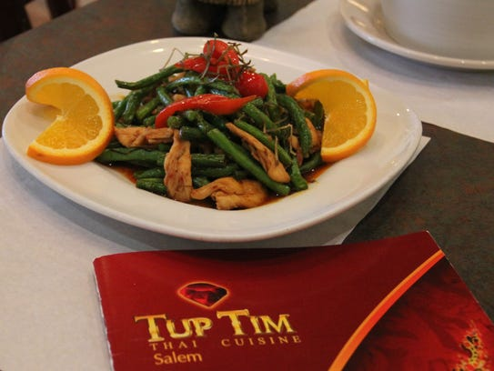Tup Tim Thai Cuisine chefs stir-fry bell peppers, green