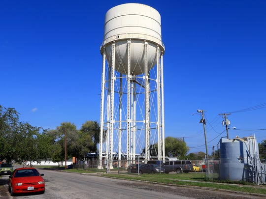 An elevated storage water tank is located next to a residents Saturday, Dec. 17, 2016, in Corpus Christi.