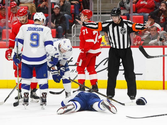 Lightning defenseman Dan Girardi (5) lies on the ice after being hit by a puck against the Red Wings in the second period on Sunday, Jan. 7, 2018, at Little Caesars Arena. Girardi was helped off the ice.