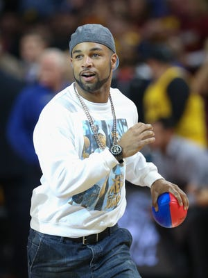 Detroit Lions wide receiver Golden Tate throws footballs to fans during the Detroit Pistons' game against the Cleveland Cavaliers on Tuesday, Nov. 17, 2015, at the Palace of Auburn Hills.