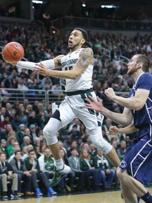 Michigan State Spartans Denzel Valentine scores against Penn State Nittany Lions Jack Donovan during first half action on Sunday, February 28, 2016 at the Breslin Center in East Lansing MI.