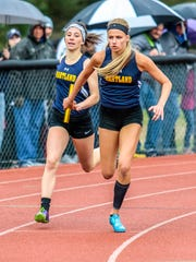 Hartland's Lindsey Strutz (receiving baton) was on