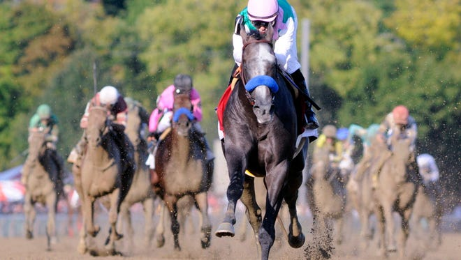 Arrogate, with Mike Smith aboard, set a track record winning The Travers Stakes on Saturday.