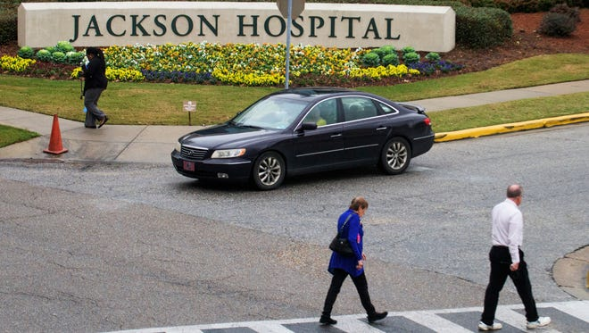 Pedestrians use a crosswalk at Jackson Hospital in  Montgomery, Ala. on Tuesday December 22, 2015. Jackson Hospital and the City of Montgomery have announced a plan to make the area safer for pedestrians.