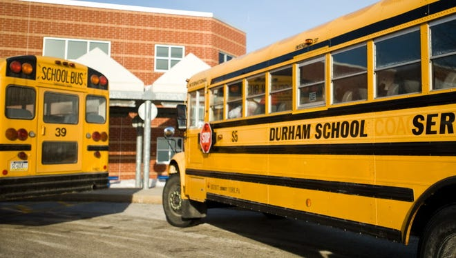 School buses wait at a local school.