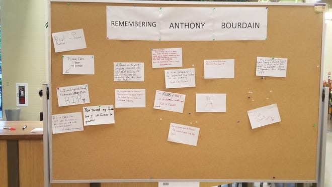 A makeshift tribute to Anthony Bourdain sits in the C.I.A. on Friday.