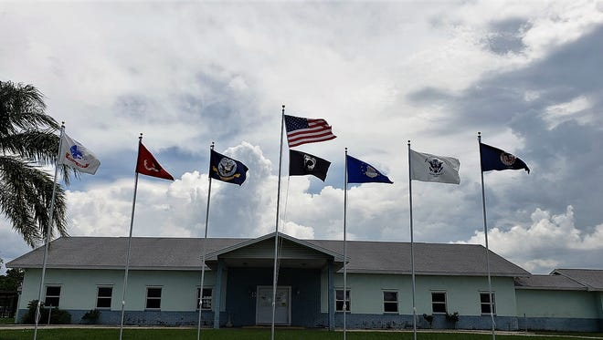 American, POW-MIA and those representing the Army, Navy, Marines, Coast Guard and Merchant Marine whip in the breeze in front of the Hollywood Estates clubhouse in West Melbourne.