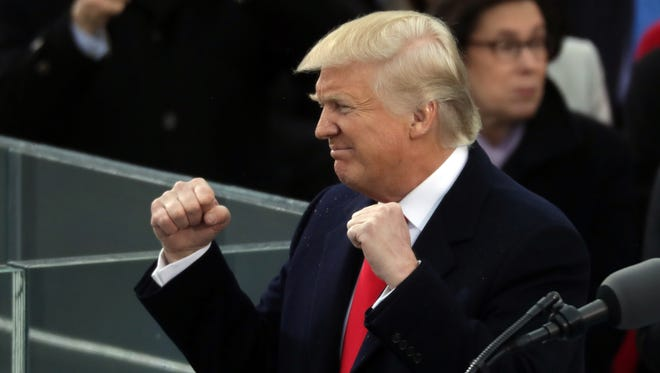 Donald Trump, double-fisted.