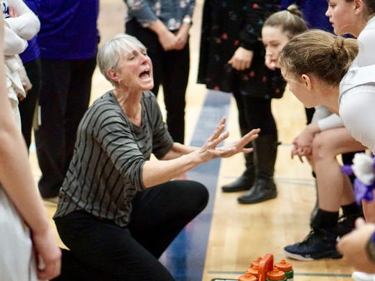 North Kitsap girls basketball coach Penny Gienger talks to her team during Saturday's regional win against Renton.