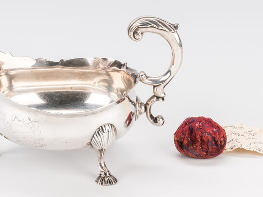 This silver sauceboat, up for auction Saturday, is believed to have been given Chief Justice John Marshall by America's first president, George Washington.