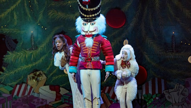 "Accompanied by their Nutcracker Prince (Ethan Kimbrell), Clara (Salome Isabel Tregre, left) and Minnie the Poodle (Gracie Paff) are about to do battle with a herd of ruthless, human-sized mice. It's one of the most memorable scenes in Cincinnati Ballet's ""Frisch's Big Boy Presents The Nutcracker,"" running at Music Hall through Dec. 24."