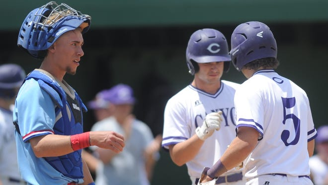 Cooper catcher Brandon Boshears, left, looks on after Canyon celebrates a run in the third inning in the first game of a doubleheader Saturday, May 6, 2017 in Lubbock. Cooper won the game 14-4 in five innings to even the best-of-three Region I-5A bi-district series at 1-1. The Coogs went on to sweep the doubleheader to win the series. Boshears was an emergency starter at catcher after Jacob Hummel was hurt in Game 1 on Friday.