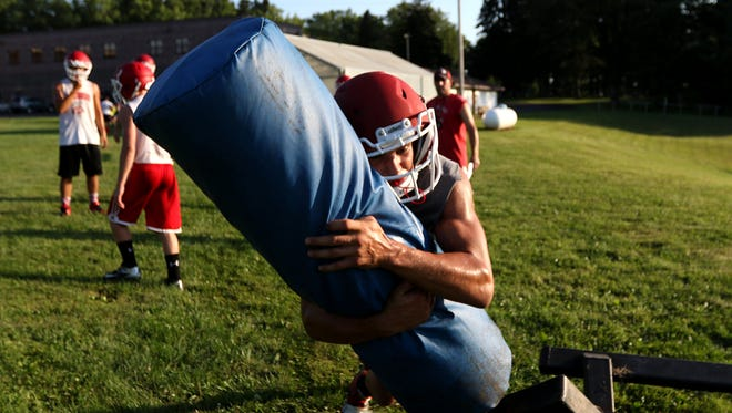 A Greenwood/Granton football player throws himself into a tackle during practice August 3, 2016.